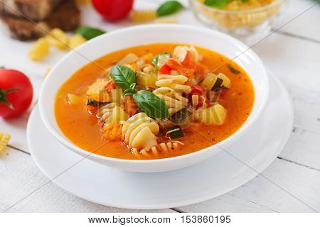 Minestrone, Italian Vegetable Soup With Pasta On White Wooden Table