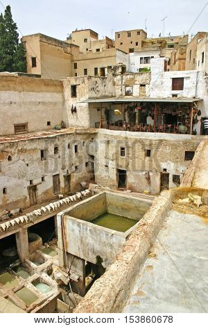 City skyline and view of rooftops drying hides and dye pots at a leather tannery at the Terrace de Tanneurs in the ancient medina Fes el Bali in Fez Morocco