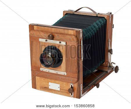 Old vintage wooden studio photo camera on white background