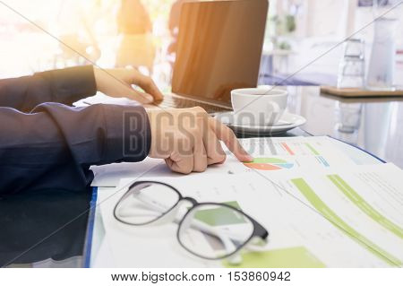 business man discussing documents and using comupter laptop