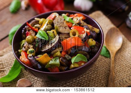 Hot Spicy Stew Eggplant, Sweet Pepper, Olives And Capers With Basil Leaves.