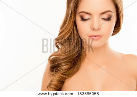 Portrait of sensual woman with closed eyes showing her long lashes