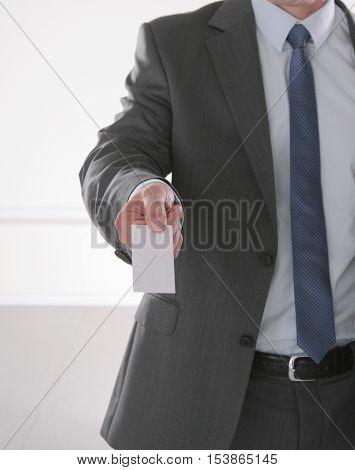 Busines Man Holding Name Card On Black