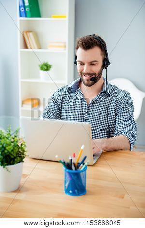 Happy Young Operator Of Call Center With Head-phones Smiling