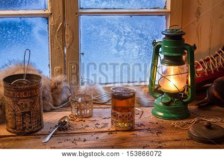 Hot tea in cold winter day on old wooden table