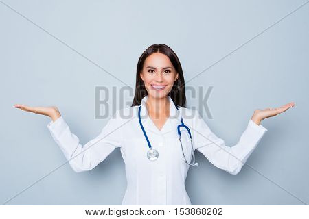 Portrait Of Cheerful Young Doctor Making Presentation Of New Medicines