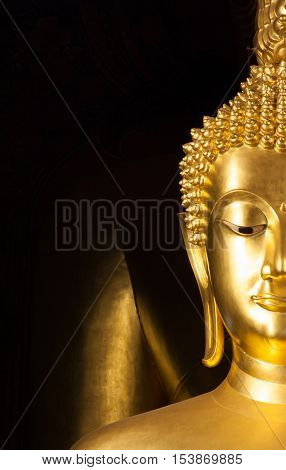 Close up of golden Buddhist statue face