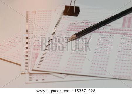 answer sheet test score sheet with pencil on test paper answers in education