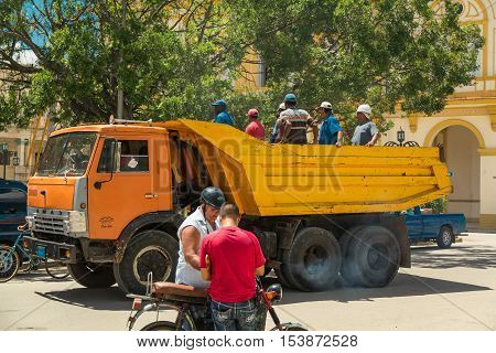 Cayo Coco island, Moron town, Cuba, July 23, 2013, Workers were transported by a dump truck to the job site on sunny hot day