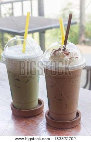 Iced coffee with iced green tea in coffee shop, stock photo