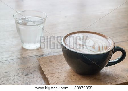 Hot cup of coffee on wooden table stock photo
