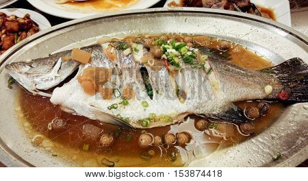 Chinese style steamed Snapper fish with soy sauce