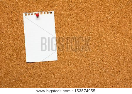 Note paper pinned on cork board background