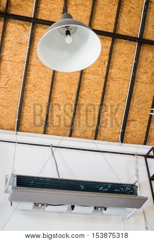 Ceiling type hanging air conditioner unit stock photo