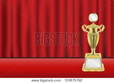 a golden trophy with red curtain background