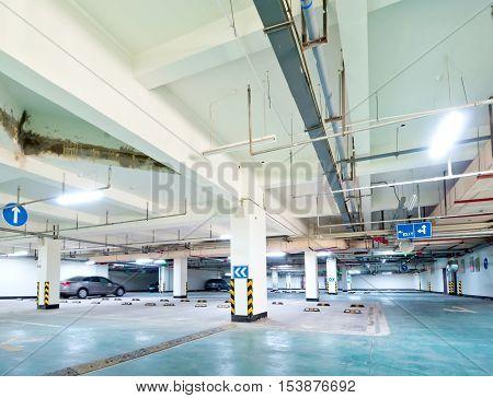Indoor open air garage or car park.