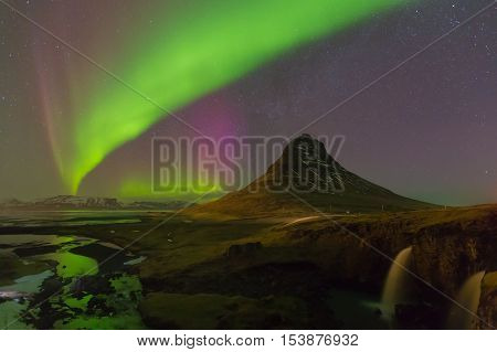 Northern Light over Kirkjufell volcano with fully of star on the sky, winter season in Iceland