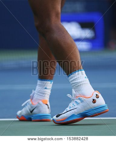 NEW YORK - AUGUST 29, 2016: Grand Slam champion Rafael Nadal of Spain wears custom Nike tennis shoes during US Open 2016 first round match at Billie Jean King National Tennis Center