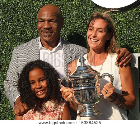 NEW YORK -AUGUST 29, 2016:Former boxing champion Mike Tyson (L) with daughter and US Open 2015 champion Flavia Pennetta attend US Open 2016 opening ceremony at USTA National Tennis Center in New York