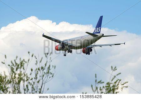 SAINT PETERSBURG, RUSSIA - MAY 17, 2016: Airbus A319-131 (OY-KBR)-- SAS Scandinavian Airlines before landing in Pulkovo airpor