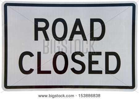 Road Closed Sign black text on dirty white sign isolated on white background. Textured sign.