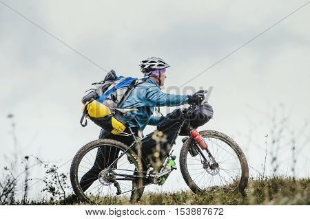 Privetnoye Russia - September 21 2016: male cyclist traveler bike with a backpack uphill during Crimean race mountainbike