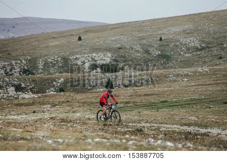 Privetnoye Russia - September 21 2016: cyclist mountainbiker on sport bike rides in mountains during Crimean race mountainbike