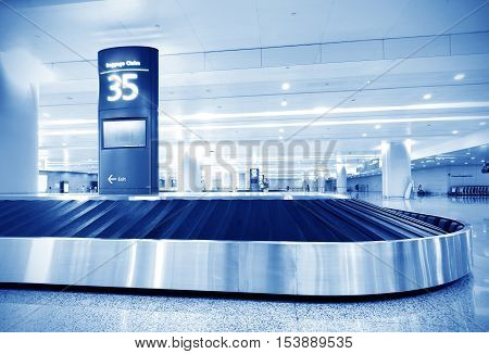 Airport luggage compartment inside the security conveyor....