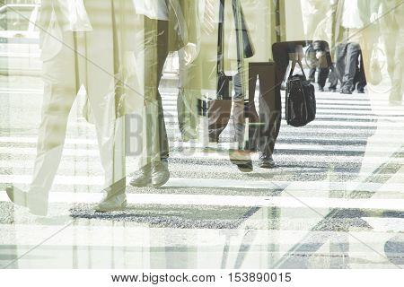 Multiple exposure image of businessman walking background