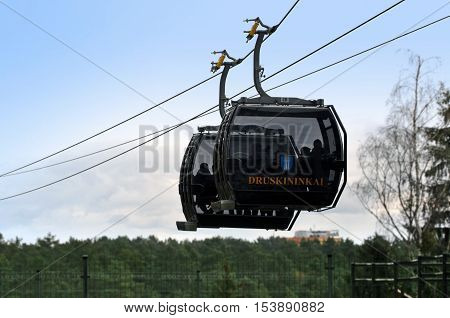 Druskininkai, Lithuania - October 26, 2016: Two black traveling cabins of ropeway of ski