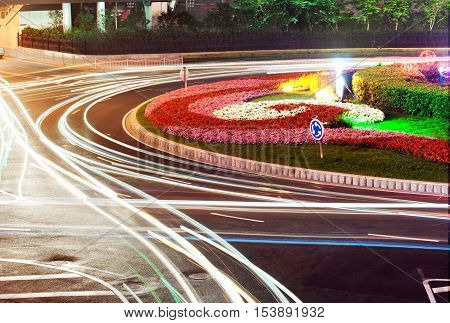 Beautiful light trajectory in the busy highway