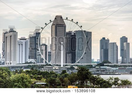 SINGAPORE: 1 October 2016: View of Singapore flyer, the largest ferris wheel in Singapore with skyline as background