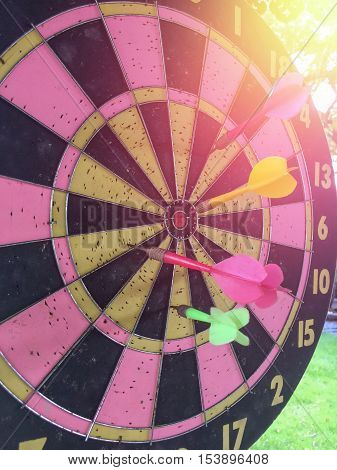 Dartboard is the target and Dart is an opportunity blur on success. represent a challenge. Bullseye and Dart. opportunity. risk management. business concept.
