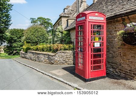 Defibrillator in a lovely telephone booth in the english village of Upper Slaughter Cotswolds