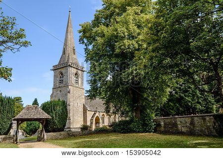 Church in Lower Slaughter Cotswolds a blue sky day