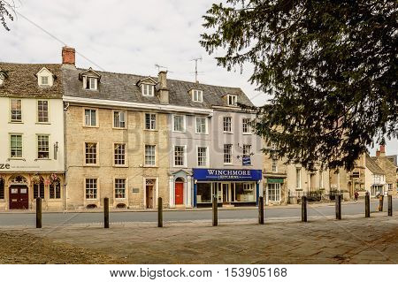 Cirencester UK - August 17 2015: Street in the center of the town near the church. The city is a market town in the cotswolds and is known to be an important early Roman area.