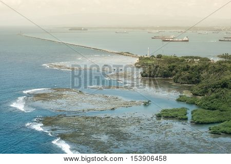 Aerial view of Panama Canal on the Pacific side. Large cargo ships waiting to go through the Panama Canal.