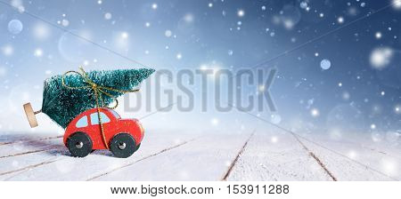 Red Car Carrying Christmas Tree With Snowfall