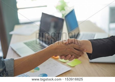 shot of businessmen handshaking. acquisition concept. businessmen handshaking