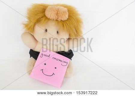 good morning message and baby doll on background white