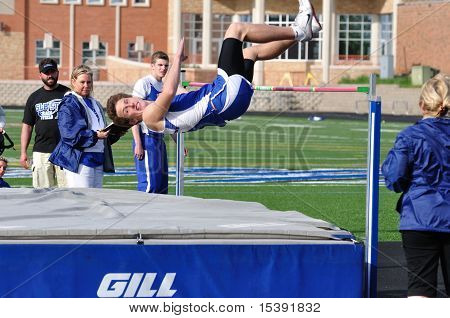 Teen Boy Doing The High Jump At A High School Track And Field Meet