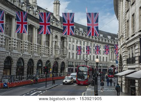 London, the UK - May 2016: National flags at Regent street