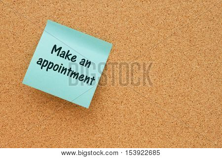 A reminder to make an appointment Bulletin board with a blue sticky note with text Make an appointment