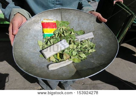 Gifts for miners, presented in bowl, coca leaves and dynamite, Potosi, Bolivia