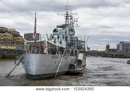 London, the UK - May 2016: HMS Belfast museum ship at the Thames river