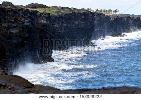 Big Surf hitting the lava shores at the end of Chain of Craters Road in Hawaii Volcanoes National Park
