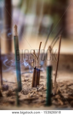 Incense burning at a Shinto Shrine, Japan. The fragrant incense sticks are believed to have healing powers and are part of traditional culture throughout Asia. Intentional shallow depth of field.