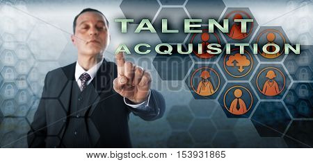 Confident human resources manager is picking TALENT ACQUISITION onscreen. Business concept and technology metaphor for the strategic planning and management of future human capital requirements.