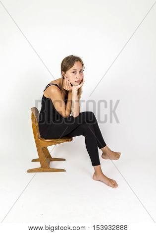 Young Girl With Brown Hair Sitting On A School Chair