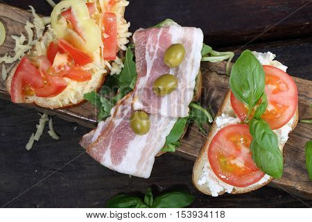 bruschetta with ham bruschetta with cottage cheese and tomatoes on a wooden table